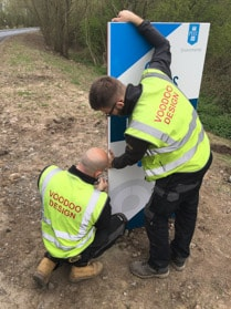 A sign being installed by skilled sign installation specialists