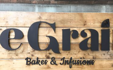 Cafe Sign in close up. Warm wood. Warm Welcome