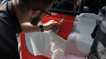 Vinyl Lettering being applied by a vinyl application specialist