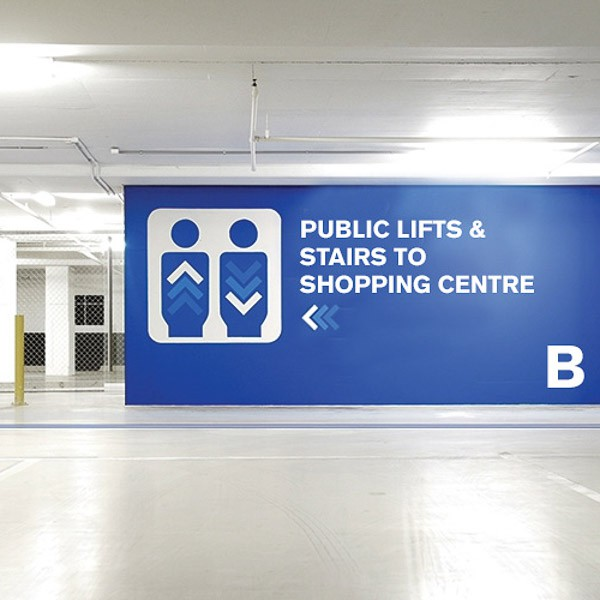 Digitally printed, way finding wall graphics informing direction in a car park