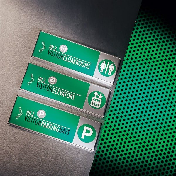 Wall mounted directional signs with green colour coding
