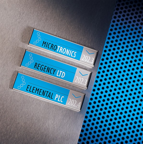 Wall mounted directional signs with blue colour coding