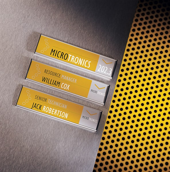 Wall mounted directional signs with yellow colour coding