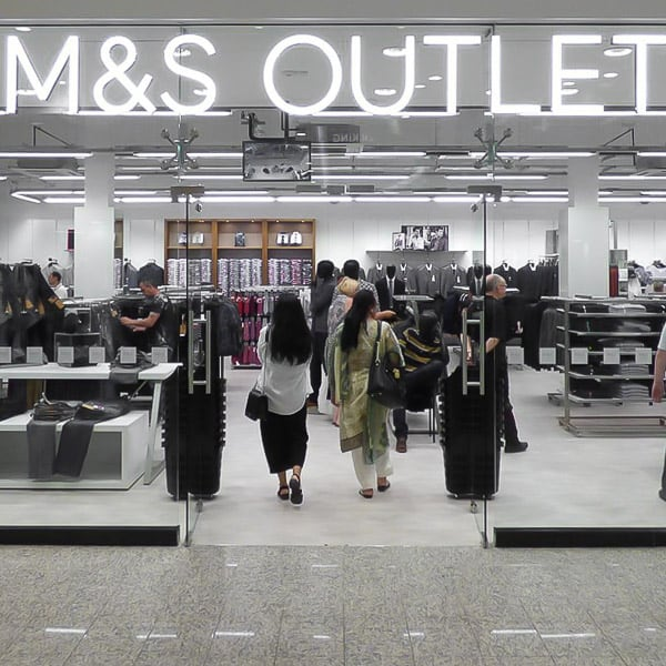Internally LED illuminated built up letters reading M&S on the Lowry Outlet store front