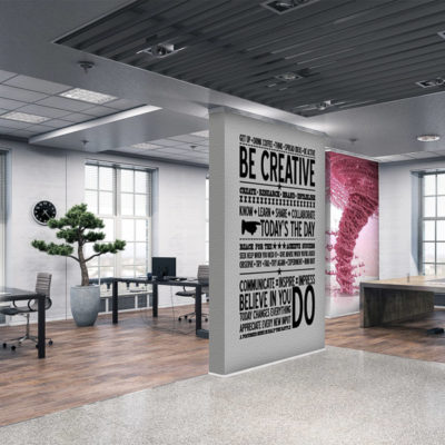 Signs and graphics used in an office environment on a wall