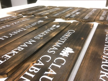 Natural Wooden Signage - Being fabricated with white vinyl cut lettering