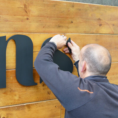 Installation of an external sign using acrylic letters onto a wooden fascia