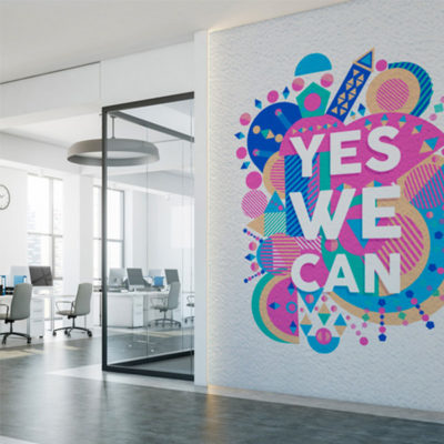 A vinyl wall graphic shown just after application in an office