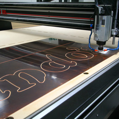 A restaurant sign being machined on the bed a CNC router