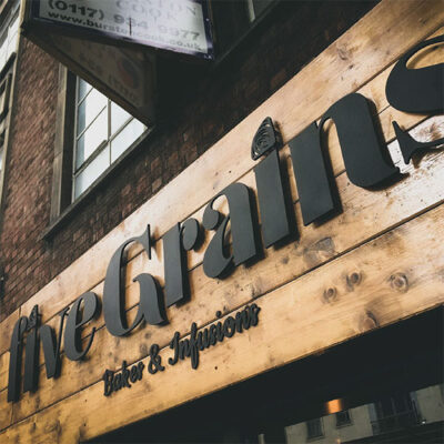 Routed letters and fascia utilising natural materials for a restaurant