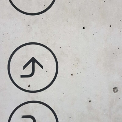 Wayfinding and Directional Signs applied directly to concrete