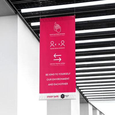 A banner at a shopping centre with with Social Distancing Graphics
