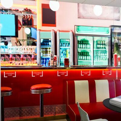 Custom wall graphics depicting a bar scene