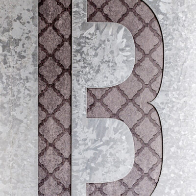 Corian letter with etched metal inlay