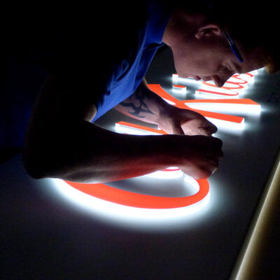 Illuminated push through lettering sign for Cath Kidston