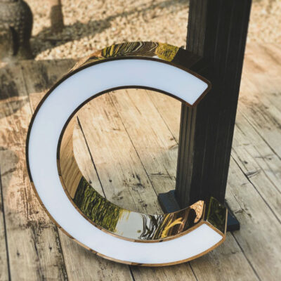 Rim and return metal letter with an illuminated acrylic face