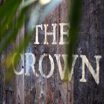 Rustic looking wooden sign for a pub
