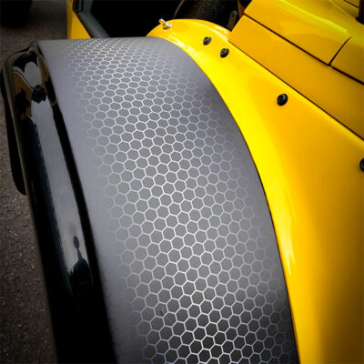 Surface transformation of a vehicle with carbon fibre effect