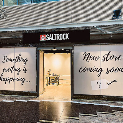 Temporary storefront graphics advising of new tenant coming soon
