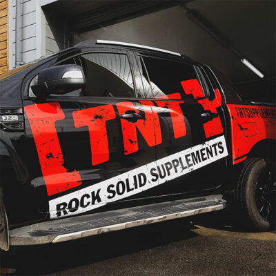 A vehicle graphic for TNT Supplements