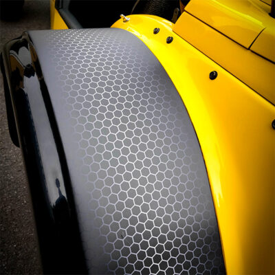 Vehicle body surface transformation graphics in carbon fibre